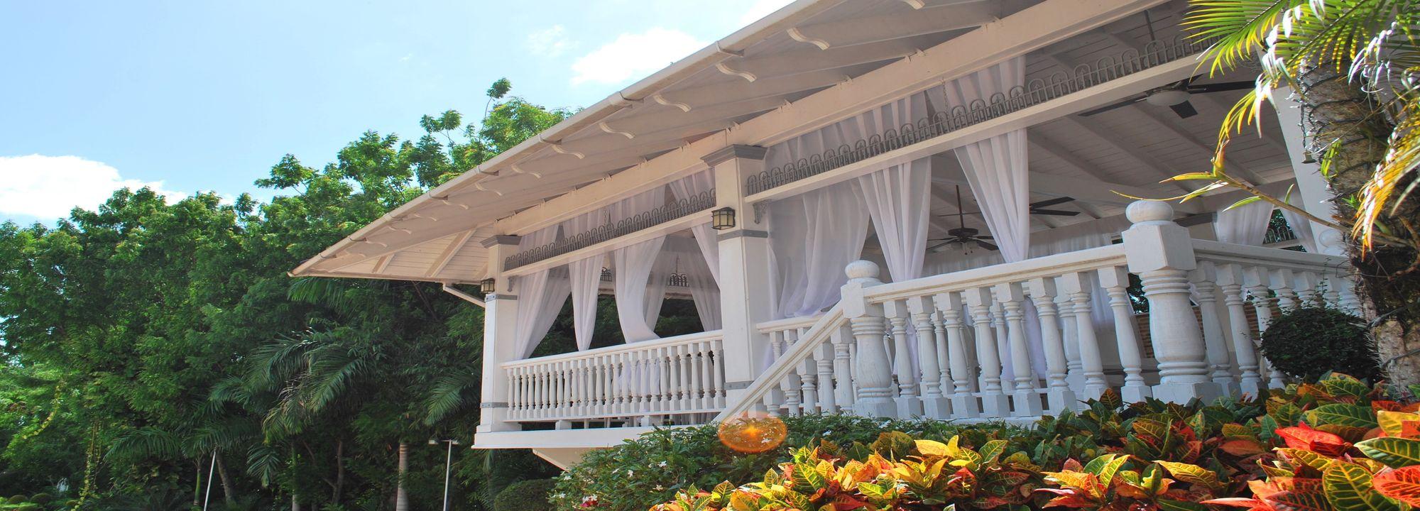 Hotel terrace overlooking garden at Platino Hotel & Casino located in Santiago Dominican Republic